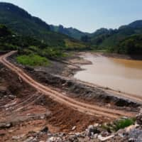 A dam collapsed at around midday on June 7, inundating roads, orchards and fields in Yangshuo county's Shazixi village, residents said. | REUTERS