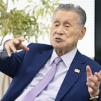 Tokyo Olympic Organizing Committee President Yoshiro Mori says he's against the idea of holding next summer's Tokyo Olympics without spectators. | KYODO