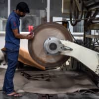 As India's coronavirus cases exceeded one million last week, unions say similar spikes in infections in reopened factories are putting workers at risk — accusing companies of skimping on health and safety as they rush to get business back on track. | AFP-JIJI