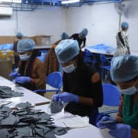 Labor advocates in India say the measures in place at factories do not go far enough, calling for more routine inspections, guaranteed living wages, as well as housing and transportation for workers during the pandemic. | AFP-JIJI