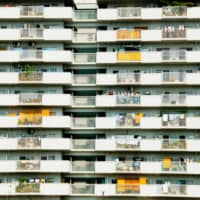 Practical living: In Japan, the balcony has historically been a utilitarian space for drying laundry and storing supplies. | GETTY IMAGES