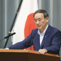 Chief Cabinet Secretary Yoshihide Suga speaks at a news conference at the Prime Minister's Office Wednesday. | KYODO