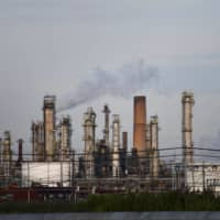 Smoke rises from oil refinery stacks at a plant in Philadelphia. | REUTERS