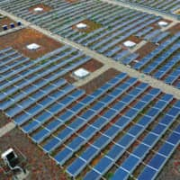 Solar panels sit on top of a warehouse near the hydrogen electrolysis plant at Energiepark Mainz, operated by Linde AG, in Mainz, Germany. About 40 percent of the electricity in the first half in the 27 EU countries came from renewable sources, compared with 34 percent from plants burning fossil fuels. | BLOOMBERG