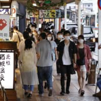 Travelers cautious of virus as Japan four-day weekend starts