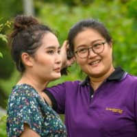 Mimi (left) and Nikki Lohitnavy at their GranMonte Vineyard and Winery in Nakhon Ratchasima, around 170 kilometers northeast of Bangkok.  | AFP-JIJI