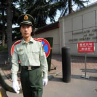 A Chinese paramilitary policeman stands guard at the entrance of the U.S. consulate in Chengdu in 2012.  | AFP-JIJI