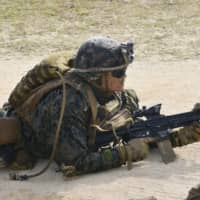 A U.S. Marine takes part in a joint exercise with Japan's Ground Self-Defense Force in February in Okinawa. | KYODO