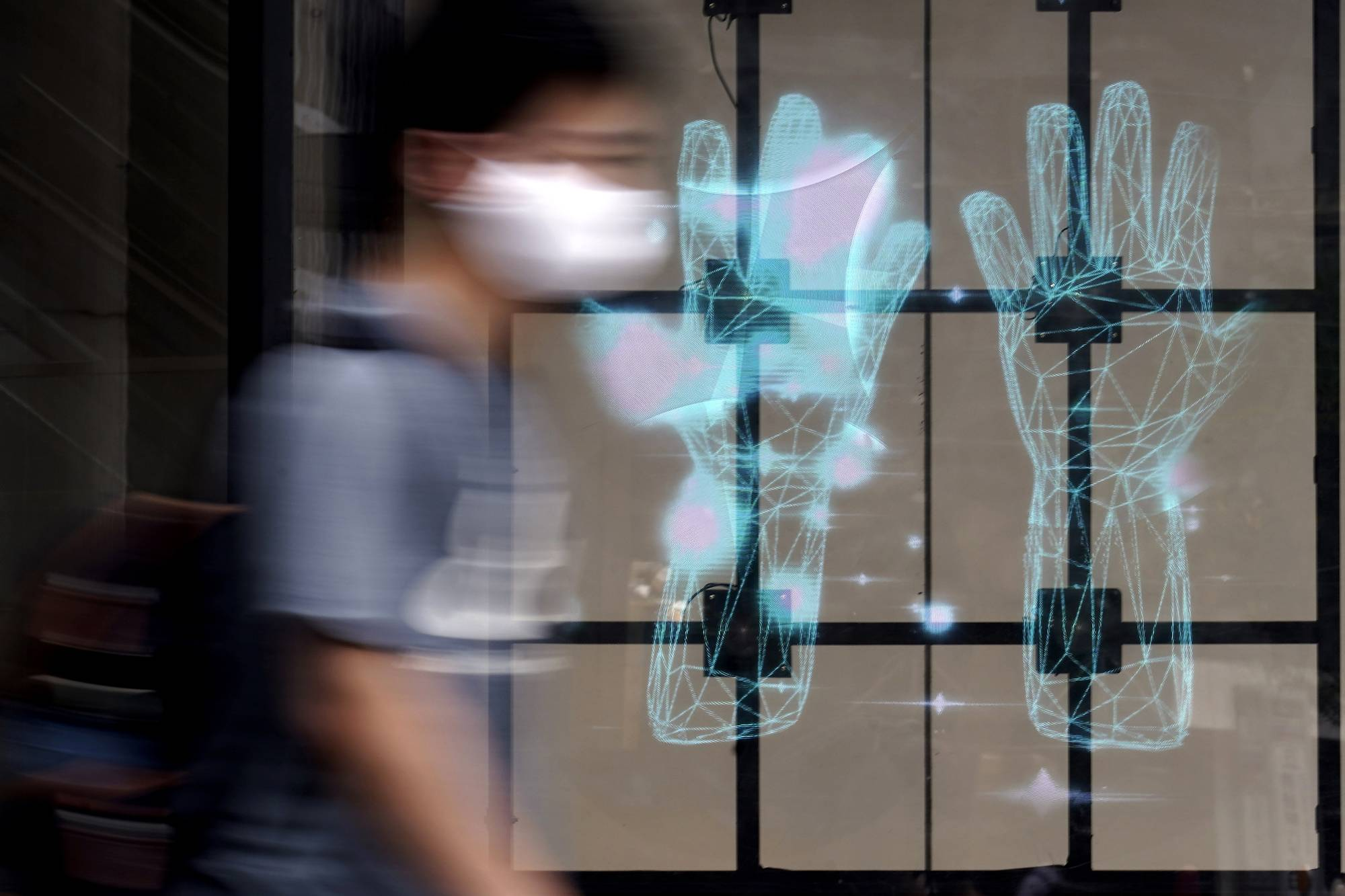 A man walks past a public notice advising people to wash their hands in Tokyo on Tuesday.    AP