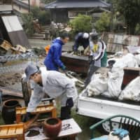 Residents of the village of Kuma, Kumamoto Prefecture, brace for another round of torrential rain expected this weekend. They are still reeling from the previous damage caused by heavy rain earlier this month. | KYODO