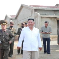 North Korean leader Kim Jong Un visits the under-construction Kwangchon Chicken Farm in this undated photo. More than 40 countries haveaccused the North Korea of illicitly breaching a United Nations cap on refined petroleum imports. | KCNA / VIA REUTERS