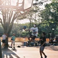 Catching air: Kisara Washington takes a shot during a game on the A Court in Tokyo's Yoyogi Park. | DAN BUYANOVSKY