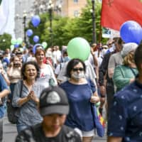 People march during an unsanctioned protest in support of Sergei Furgal, the governor of the Khabarovsk region, who was interrogated and ordered held in jail for two months, in Khabarovsk, Russia, on Saturday.    AP