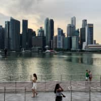 Singapore reshuffles Cabinet, giving finance minister new role
