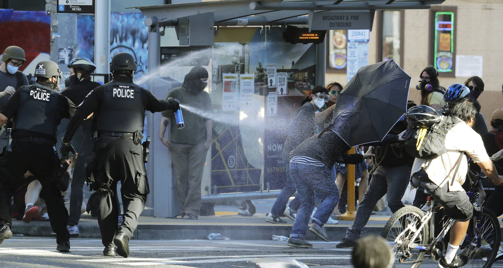 Police pepper spray protesters in Seattle on Saturday.  | AP