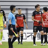 Grampus players leave the pitch after their draw with Gamba on July 8 in Toyota, Aichi Prefecture. | KYODO