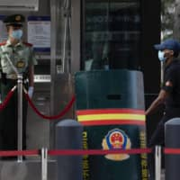 Staff leaving U.S. Chengdu consulate under high security as deadline looms