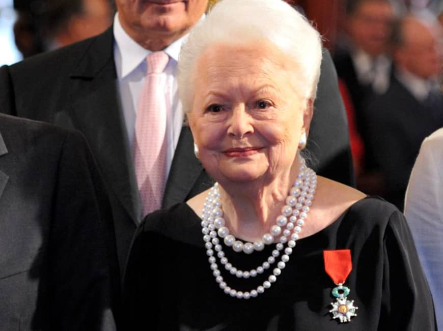 Actress Olivia de Havilland looks on after being awarded the Legion d