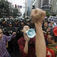 Police block protesters from accessing the U.S. Consulate in Chengdu during a protest against Japan's decision to purchase the disputed Senkaku Islands in September 2012.  | REUTERS