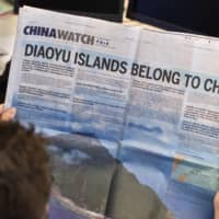 A two-page advertisement about the territorial dispute between China and Japan over the Senkaku Islands in the East China Sea is seen in The New York Times in September 2012. | REUTERS