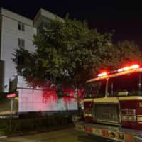 A firetruck responds to reports that documents were being burned in the courtyard of the Chinese Consulate in Houston on Wednesday after the U.S. government ordered China to close it. | AP