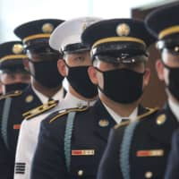 United Nations Command honor guards stand during the commemorating ceremony for U.N. Forces Participation Day in the Korean War at the border village of Panmunjom in Paju, South Korea, on Monday. | POOL / VIA AFP-JIJI