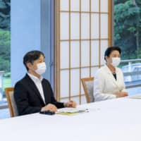 Emperor Naruhito and Empress Masako listen to experts on the coronavirus during a briefing at their residence in Tokyo earlier this month. | IMPERIAL HOUSEHOLD AGENCY / VIA KYODO