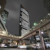 Dentsu Group Inc., headquartered in Tokyo's Shiodome district, gained the contract through a related firm and subsequently subcontracted the work out through the group. | KYODO