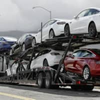 Despite various challenges, Tesla has posted three straight profitable quarters, yet analysts are beginning to question whether the run will last. | AP / FILE PHOTO
