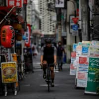 The coronavirus aid was meant to help businesses like Takenobu Tonegawa's video production firm, which took a massive hit due to the pandemic and forced the Tokyo-based entrepreneur to find work delivering food on his bicycle for Uber Eats as he waited weeks for his $10,000 payment from the government. | REUTERS