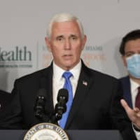 U.S. Vice President Mike Pence speaks during a news conference with Food and Drug Administration Commissioner Dr. Stephen Hahn (left) and Florida Gov. Ron DeSantis, in Miami on Monday.  | AP