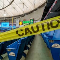 Caution tape blocks off a section of the stands at Tropicana Field in St. Petersburg, Florida, before a game between the Toronto Blue Jays and the Tampa Bay Rays. | USA TODAY SPORTS