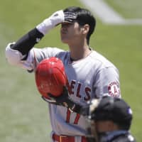 Angels two-way player Shohei Ohtani reacts after striking out in the first inning against the Athletics on Monday in Oakland, California. | AP