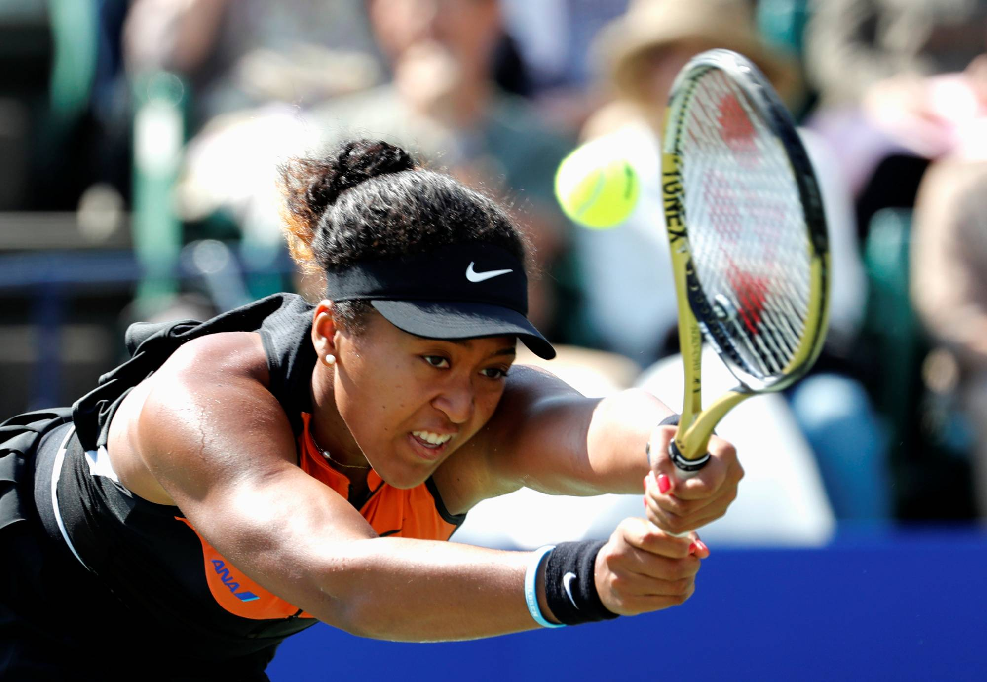 Naomi Osaka returns the ball during her Pan Pacific Open quarterfinal match on Sept. 21 in Osaka. | REUTERS