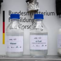 Bottles containing e-fuel | GETTY IMAGES/ PICTURE ALLIANCE / VIA BLOOMBERG