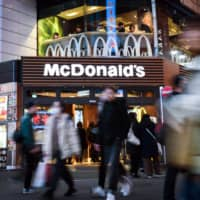 McDonald's says it will divest a significant stake in its Japan business as it looks to save cash amid the COVID-19 pandemic.  | BLOOMBERG