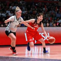 Former Japan women's team guard Manami Fujioka (right) dribbles against Belgium's Julie Vanloo during an exhibition series last year in Mito, Ibaraki Prefecture. | KAZ NAGATSUKA