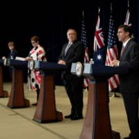 Australia's Defense Minister Linda Reynolds (far left) and Foreign Minister Marise Payne hold a joint news conference with U.S. Secretary of State Mike Pompeo and Defense Secretary Mark Esper in Washington on Tuesday.  | POOL / VIA REUTERS