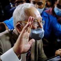 Former Malaysian Prime Minister Najib Razak departs from the Kuala Lumpur Courts Complex on Tuesday.  | BLOOMBERG