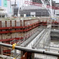 Chemical tanks are prepared for storage underground at Japan Nuclear Fuel Ltd.'s nuclear fuel reprocessing plant in Rokkasho, Aomori Prefecture.  | KYODO