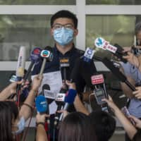 Joshua Wong, a pro-democracy activist, speaks to members of the media earlier this month before submitting his application to run in this year's Legislative Council Election in Hong Kong.  | BLOOMBERG