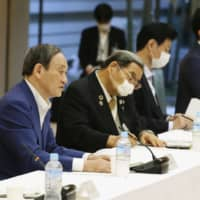 Chief Cabinet Secretary Yoshihide Suga speaks during a government meeting on tourism promotion Monday at the Prime Minister's Office. Suga floated the idea of 'workations' as a way to reinvigorate the tourism industry. | KYODO