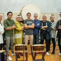 Drum up the drama: Bill Hemstapat (third from left), Chad Cannon (fifth from left), Peter Scaturro (sixth from left) with the taiko ensemble at Sound City studio in Tokyo. |