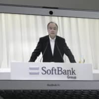 Masayoshi Son, chairman and chief executive officer of SoftBank Group Corp., is seen on a computer speaking during the company's annual general meeting in Tokyo last month. | BLOOMBERG