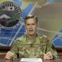 Lt. Gen. Kevin Schneider, Commander of U.S. Forces Japan, speaks from Yokota Air Base in Tokyo on Wednesday.  | U.S. FORCES JAPAN / VIA AP
