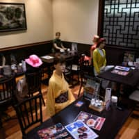 One Tokyo restaurant has turned to mannequins, seated among diners, to help enforce social distancing. | AFP-JIJI