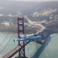 The space shuttle Endeavour and its 747 carrier aircraft soar over the Golden Gate Bridge during the final portion of its tour of California in September 2012. | NASA / VIA REUTERS