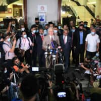 Former Malaysian Prime Minister Najib Razak speaks to members of the media after he was found guilty in a corruption trial in Kuala Lumpur on Tuesday.  | AFP-JIJI