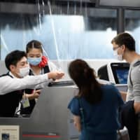 Japan to allow back foreign residents who left before entry ban