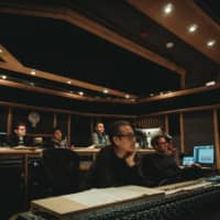Making music: Producer Peter Scaturro (far left), co-composer Shigeru Umebayashi (center) other members of the scoring team at Air Studios in London. |